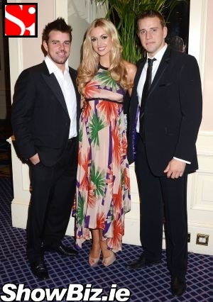 http://www.showbiz.ie/photos/2011-07-andy-quirke--rosanna-davison--wesley-quirke.jpg